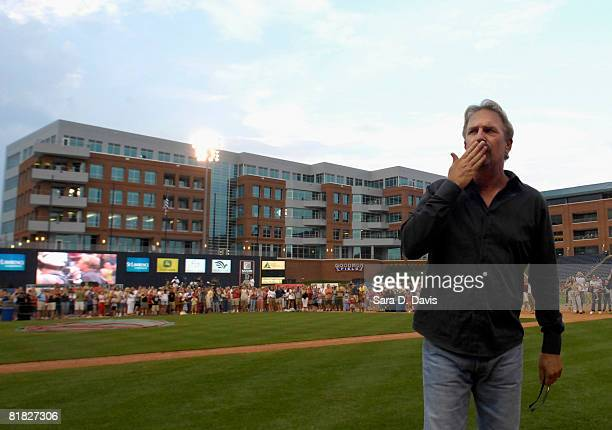 Kevin Costner blows a kiss to the crowd as VIP fans wait near the stage behind him before his concert with his band Modern West at a July Fourth...