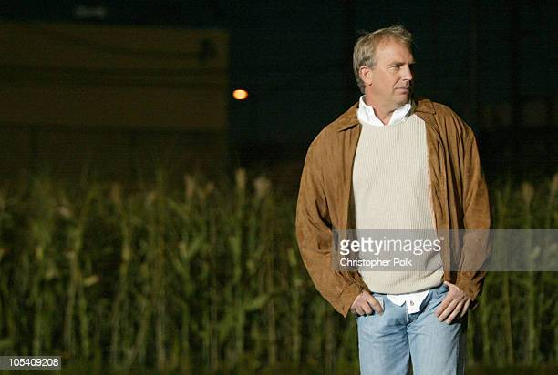 Kevin Costner emerges from rows of cornstalks as part of the celebration for the DVD release of the 'Field of Dreams' TwoDisc Anniversary Edition The...