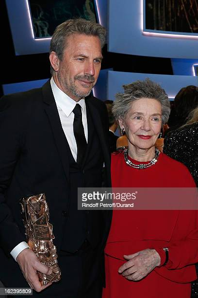 Kevin Costner holding his Cesar of Honor award and best actress Emmanuelle Riva for Amour pose on stage at the end of the Cesar Film Awards 2013 at...