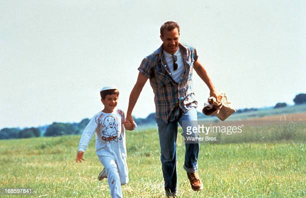 Kevin Costner holds onto a child in a scene from the film 'A Perfect World' 1993