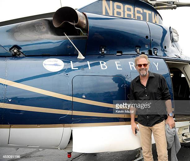 Kevin Costner in Shinola and DuJour Magazine's Jason Binn take a Liberty Helicopter to the East Hampton Airport for a screening of Costner's Black...