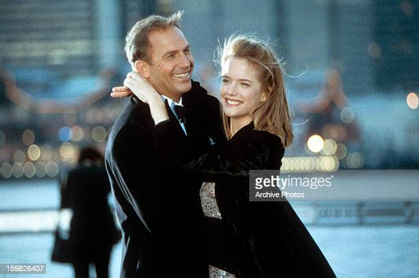 Kevin Costner is held by Kelly Preston in a scene from the film 'For Love Of The Game' 1999