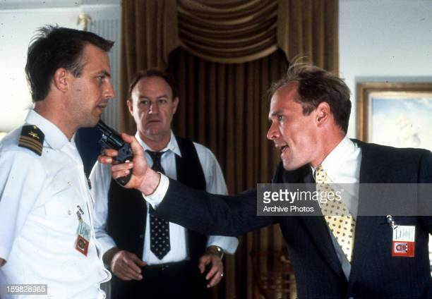 Kevin Costner is threatened by Will Patton with a gun watched by Gene Hackman in a scene from the film 'No Way Out' 1987
