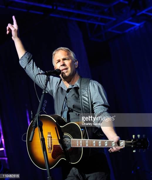 Kevin Costner performs with band Modern West onstage during Muhammad Ali's Celebrity Fight Night XVII at JW Marriot Desert Ridge Resort Spa on March...