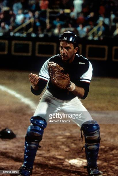 Kevin Costner playing catcher on a baseball team in a scene from the film 'Bull Durham' 1988