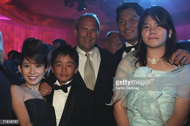 Kevin Costner poses with exSeattle Mariners Pitcher Kazuhiro Sasaki and his family at the after party for the World Premiere of 'The Guardian'...