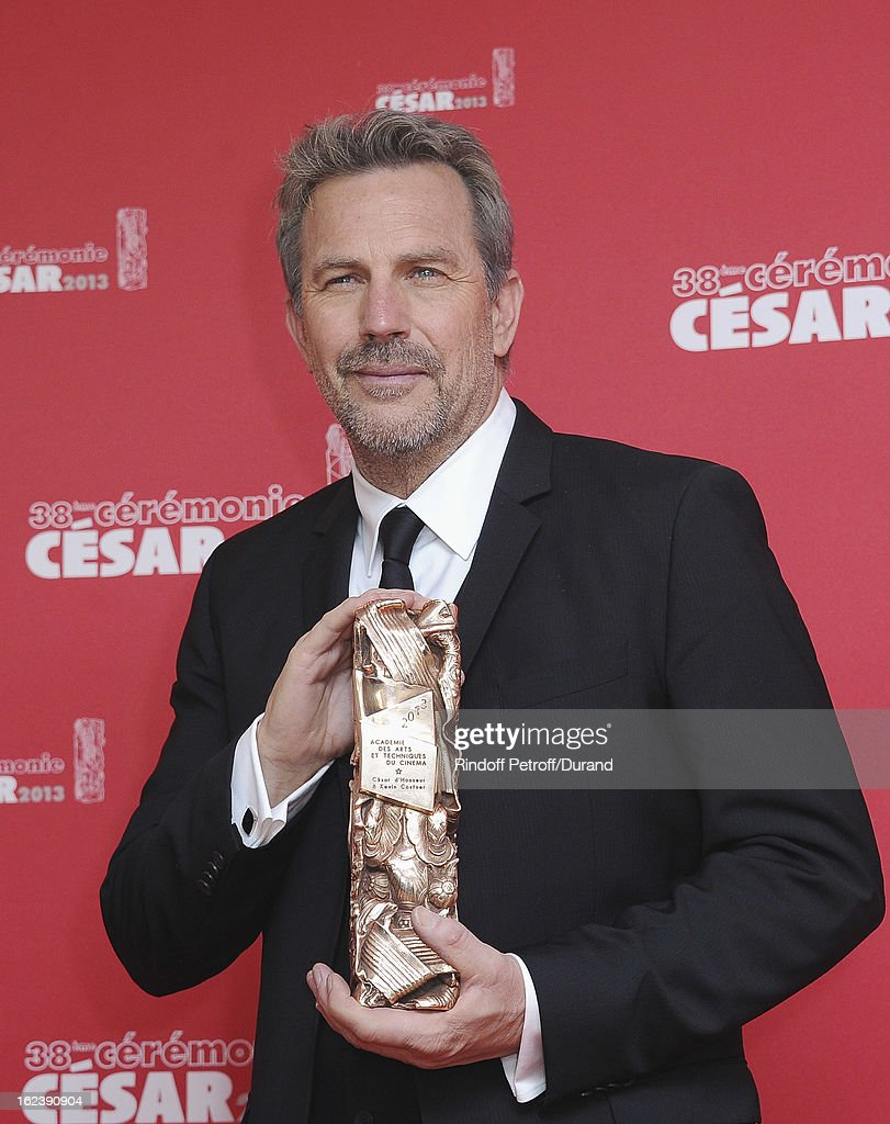 Kevin Costner poses with his trophy after receiving a lifetime achievement award during the Cesar Film Awards 2013 at Theatre du Chatelet on February 22, 2013 in Paris, France.