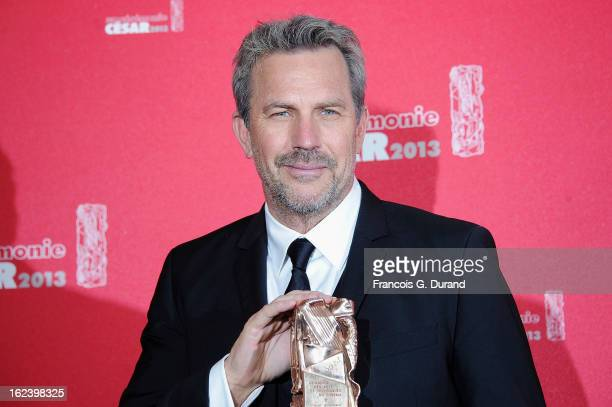 Kevin Costner poses with his trophy after receiving a lifetime achievement award during the Cesar Film Awards 2013 at Theatre du Chatelet on February...