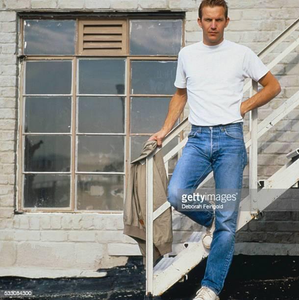 Kevin Costner Standing Holding Railing