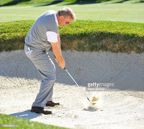 Kevin Costner sweeps the sand pit at the ATT Pebble Beach National ProAm at Pebble Beach Golf Links on February 9 2011 in Pebble Beach California