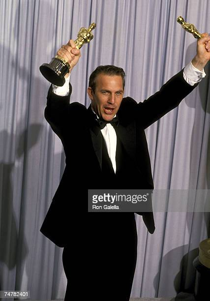 "Kevin Costner, winner of Best Picture and Best Director for ""Dances with Wolves"" at the Shrine Auditorium in Los Angeles, California"