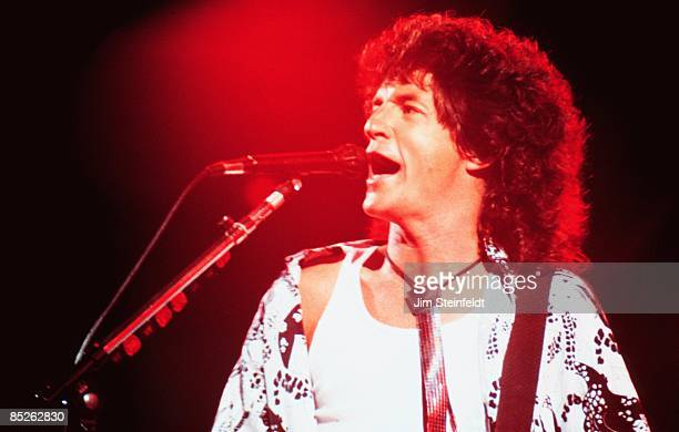 Kevin Cronin of REO Speedwagon Perform on their Wheels Are Turnin tour in Minneapolis Minnesota in July 1987