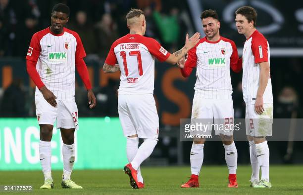 Kevin Danso Jonathan Schmid Marco Richter and Raphael Framberger of Augsburg celebrate after the Bundesliga match between FC Augsburg and Eintracht...