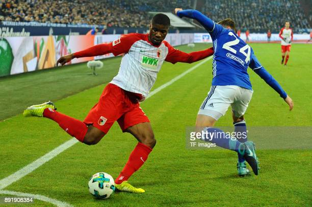 Kevin Danso of Augsburg and Bastian Oczipka of Schalke battle for the ball during the Bundesliga match between FC Schalke 04 and FC Augsburg at...