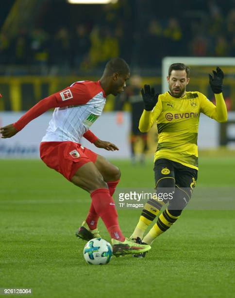 Kevin Danso of Augsburg and Gonzalo Castro of Dortmund battle for the ball during the German Bundesliga match between Borussia Dortmund v FC Augsburg...