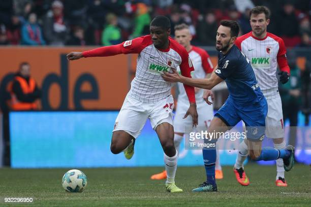 Kevin Danso of Augsburg and Lukas Rupp of Hoffenheim battle for the ball during the Bundesliga match between FC Augsburg and TSG 1899 Hoffenheim at...