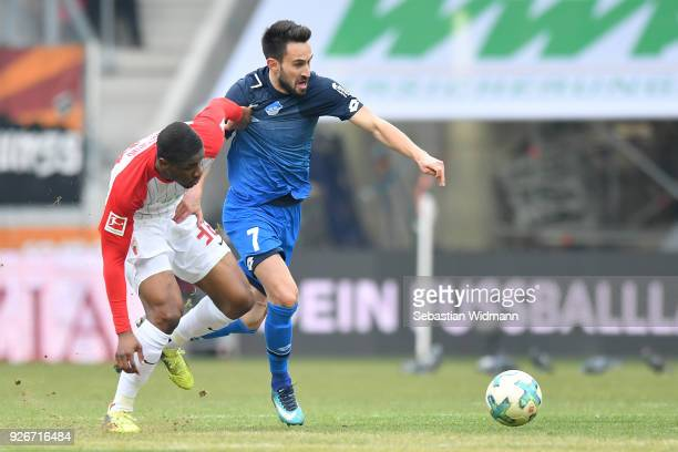 Kevin Danso of Augsburg and Lukas Rupp of Hoffenheim compete for the ball during the Bundesliga match between FC Augsburg and TSG 1899 Hoffenheim at...