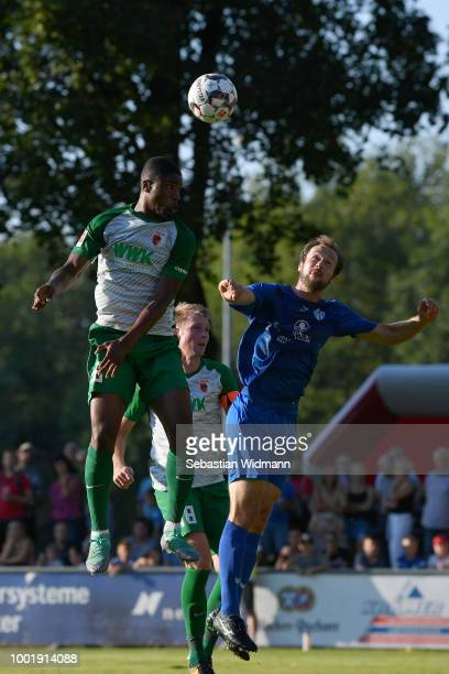 Kevin Danso of Augsburg and Mikotaj Simon of Olching jump for a header during the preseason friendly match between SC Olching and FC Augsburg on July...