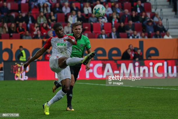 Kevin Danso of Augsburg and Niclas Fuellkrug of Hannover battle for the ball during the Bundesliga match between FC Augsburg and Hannover 96 at...