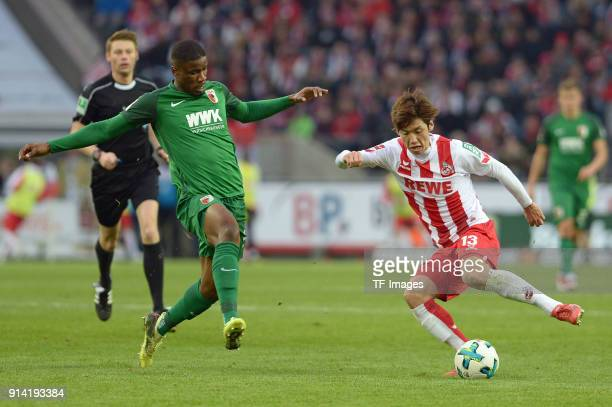 Kevin Danso of Augsburg and Yuya Osako of Koeln battle for the ball during the Bundesliga match between 1 FC Koeln and FC Augsburg at...