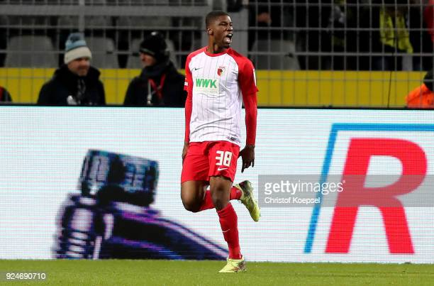 Kevin Danso of Augsburg celebrates his first goal and equalizes during the Bundesliga match between Borussia Dortmund and FC Augsburg at Signal Iduna...