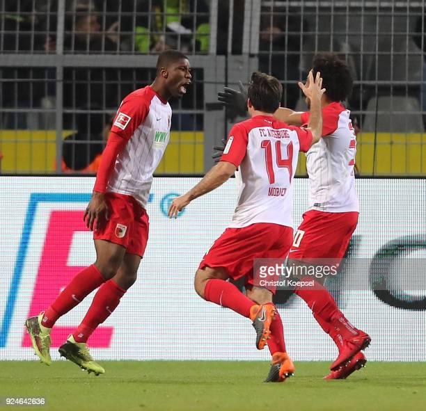 Kevin Danso of Augsburg celebrates scoring the equalizing goal with teamates during the Bundesliga match between Borussia Dortmund and FC Augsburg at...