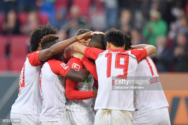 Kevin Danso of Augsburg celebrates with his teammates after scoring his teams first goal during the Bundesliga match between FC Augsburg and Bayer 04...