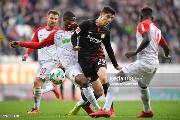 Kevin Danso of Augsburg challenges Kai Havertz of Bayer 04 Leverkusen during the Bundesliga match between FC Augsburg and Bayer 04 Leverkusen at...