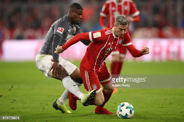 Kevin Danso of Augsburg fights for the ball with Robert Lewandowski of Bayern Muenchen during the Bundesliga match between FC Bayern Muenchen and FC...