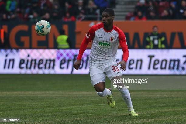 Kevin Danso of Augsburg looks the ball during the Bundesliga match between FC Augsburg and TSG 1899 Hoffenheim at WWK Arena on March 03 2018 in...