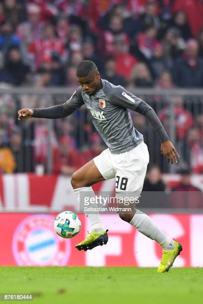 Kevin Danso of Augsburg plays the ball during the Bundesliga match between FC Bayern Muenchen and FC Augsburg at Allianz Arena on November 18 2017 in...