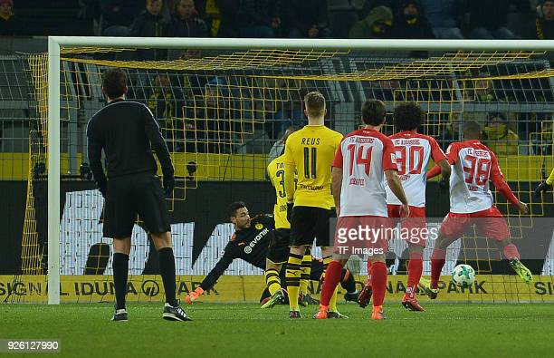 Kevin Danso of Augsburg scores the team`s first goal during the German Bundesliga match between Borussia Dortmund v FC Augsburg at the Signal Iduna...