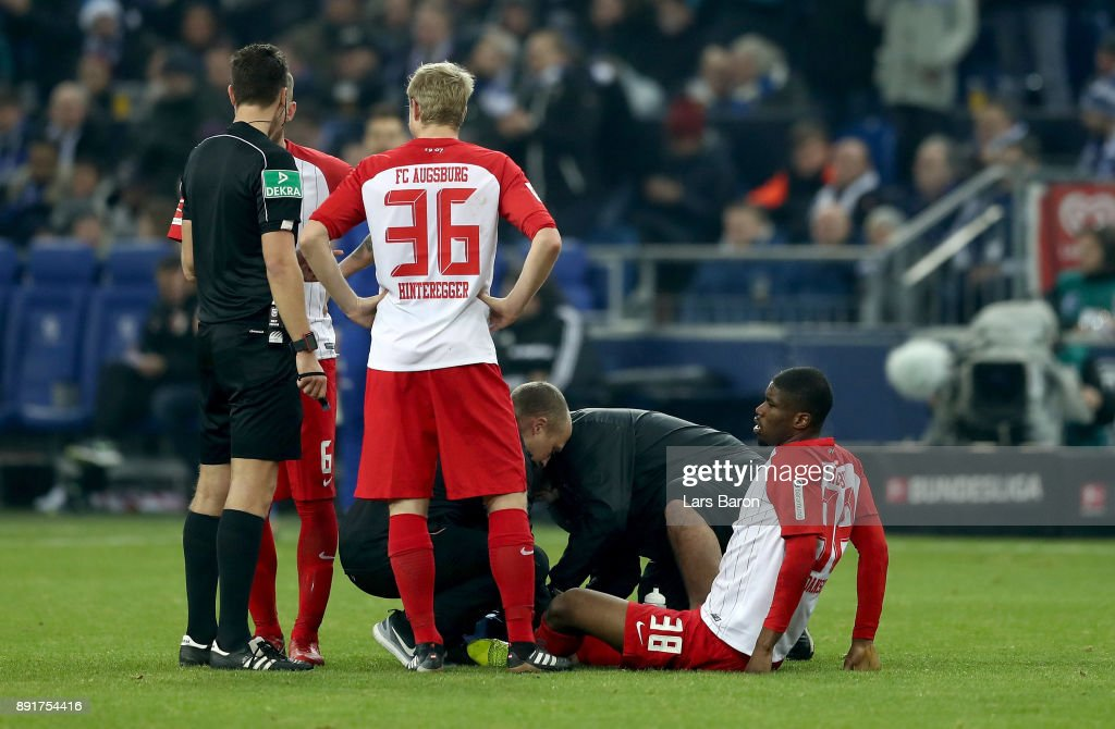 Kevin Danso of Augsburg sits injured on the pitch during the Bundesliga match between FC Schalke 04 and FC Augsburg at Veltins-Arena on December 13, 2017 in Gelsenkirchen, Germany.