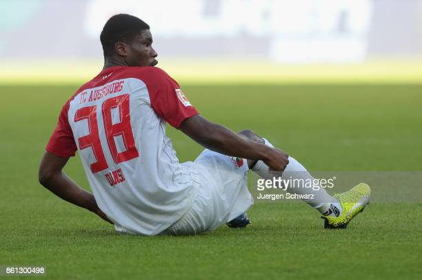 Kevin Danso of Augsburg sits on the pitch during the Bundesliga match between TSG 1899 Hoffenheim and FC Augsburg at Wirsol RheinNeckarArena on...
