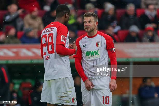 Kevin Danso of Augsburg speaks with Daniel Baier of Augsburg during the Bundesliga match between FC Augsburg and Eintracht Frankfurt at WWKArena on...