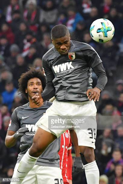 Kevin Danso of Augsburg with a header during the Bundesliga match between FC Bayern Muenchen and FC Augsburg at Allianz Arena on November 18 2017 in...