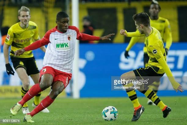Kevin Danso of FC Augsburg Julian Weigl of Borussia Dortmund during the German Bundesliga match between Borussia Dortmund v FC Augsburg at the Signal...