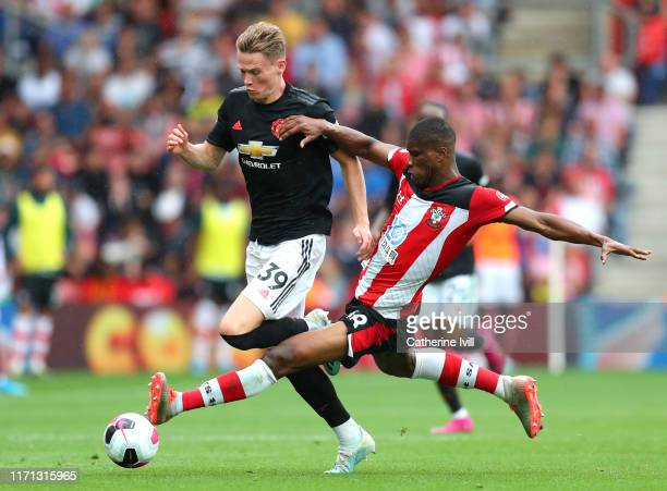 Kevin Danso of Southampton fouls Scott McTominay of Manchester United leading to a second yellow and therefore a red card for Kevin Danso during the...