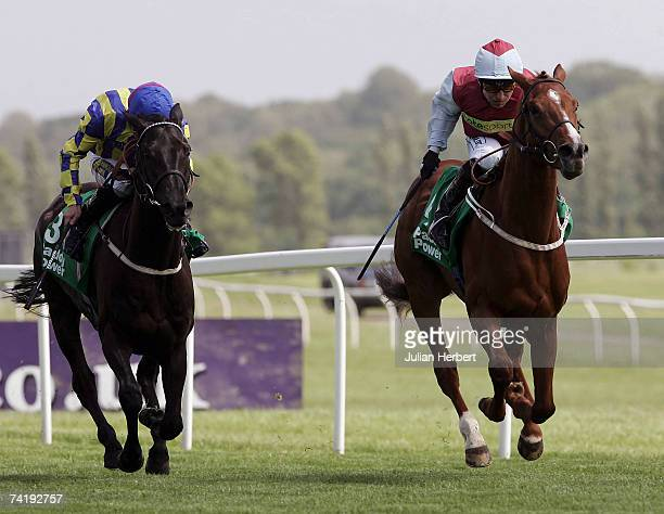Kevin Darley and Peppertree Lane lead the Steve Drowne ridden Group Captain to land The paddypowercom Stakes Race run at Newbury Racecourse on May 19...