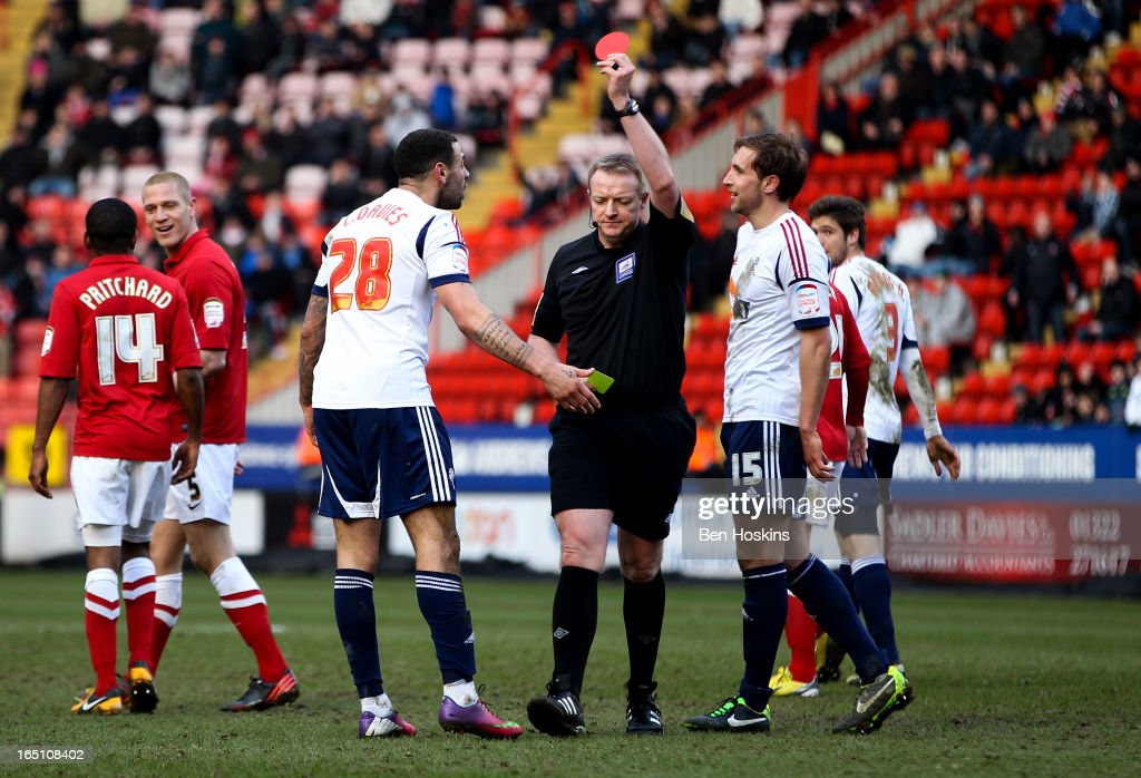 Kevin Davies (L) of Bolton is sent off by referee Trevor Kettle during the npower Championship match between Charlton Athletic and Bolton Wanderers at the Valley on March 30, 2013 in London, England.