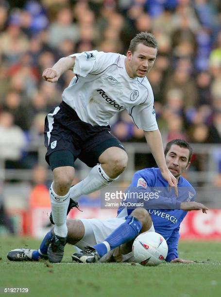 Kevin Davies of Bolton is tackled by Kevin Horlock of Ipswich during the FA Cup Third Round match between Ipswich Town and Bolton Wanderers at...
