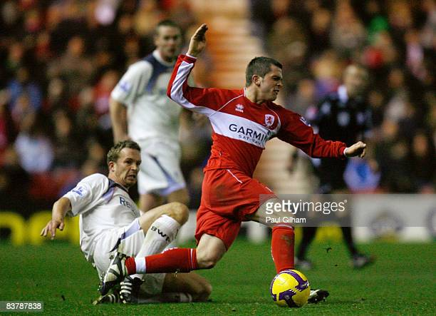 Kevin Davies of Bolton Wanderers battles for the ball with Andrew Taylor of Middlesbrough during the Barclays Premier League match between...