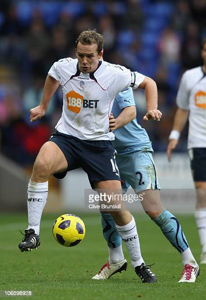 Kevin Davies of Bolton Wanderers holds off a challenge from Alan Hutton of Tottenham Hotspur during the Barclays Premier League match between Bolton...