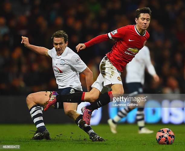 Kevin Davies of Preston North End and Ander Herrera of Manchester United battle for the ball during the FA Cup Fifth round match between Preston...