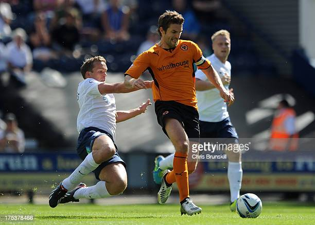 Kevin Davies of Preston North End chases Sam Ricketts of Wolverhampton Wanderers during the Sky Bet League One match between Preston North End and...