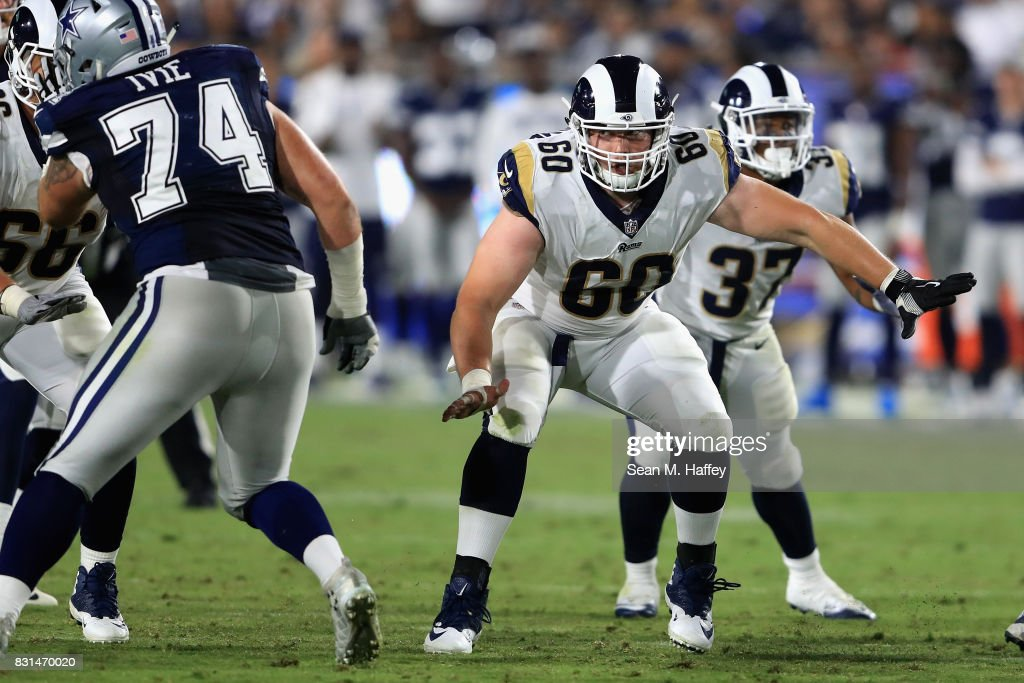 Kevin Davis #60 of the Los Angeles Rams blocks during a presason game against the Dallas Cowboys at Los Angeles Memorial Coliseum on August 12, 2017 in Los Angeles, California.