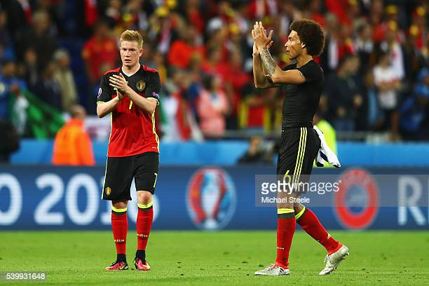 Kevin De Bruyne and Axel Witsel of Belgium applaud the supporters after the UEFA EURO 2016 Group E match between Belgium and Italy at Stade des...
