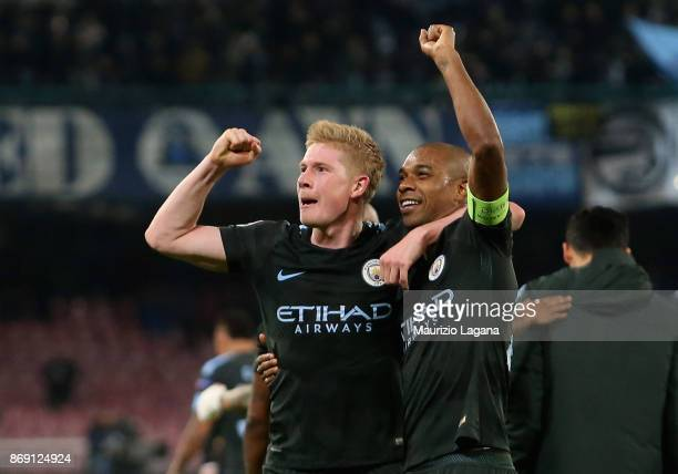 Kevin De Bruyne and Fernandinho of Manchester City celebrate after the UEFA Champions League group F match between SSC Napoli and Manchester City at...