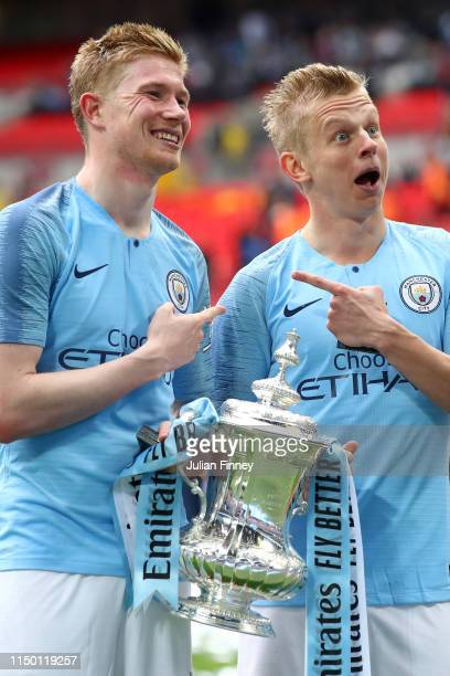 Kevin De Bruyne and Oleksandr Zinchenko of Manchester City celebrate with the trophy following the FA Cup Final match between Manchester City and...