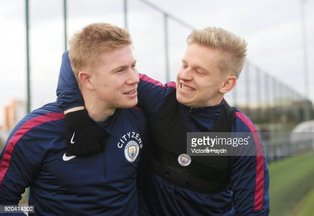 Kevin De Bruyne and Oleksandr Zinchenko reacts during training at Manchester City Football Academy on February 17 2018 in Manchester England
